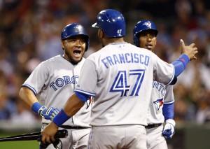Melky Cabrera comemora com Juan Francisco mais uma home run no massacre de Toronto em Boston