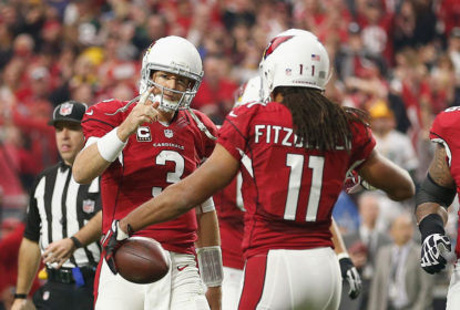 GLENDALE, AZ - DECEMBER 27: Wide receiver Larry Fitzgerald #11 and quarterback Carson Palmer #3 of the Arizona Cardinals celebrate after Fitzgerald scored a 3 yard touchdown in the second quarter of the NFL game against the Green Bay Packers at the University of Phoenix Stadium on December 27, 2015 in Glendale, Arizona.