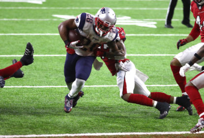 HOUSTON, TX - FEBRUARY 05: James White #28 of the New England Patriots scores the game winning two yard touchdown in overtime against the Atlanta Falcons during Super Bowl 51 at NRG Stadium on February 5, 2017 in Houston, Texas.