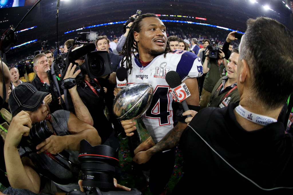 HOUSTON, TX - FEBRUARY 05: Dont'a Hightower #54 of the New England Patriots holds the Vince Lombardi Trophy after defeating the Atlanta Falcons 34-28 in overtime during Super Bowl 51 at NRG Stadium on February 5, 2017 in Houston, Texas.