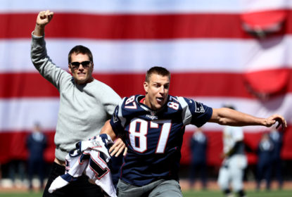 BOSTON, MA - APRIL 3: Rob Gronkowski of the New England Patriots steals Tom Brady's jersey before the opening day game between the Boston Red Sox and the Pittsburgh Pirates at Fenway Park on April 3, 2017 in Boston, Massachusetts.