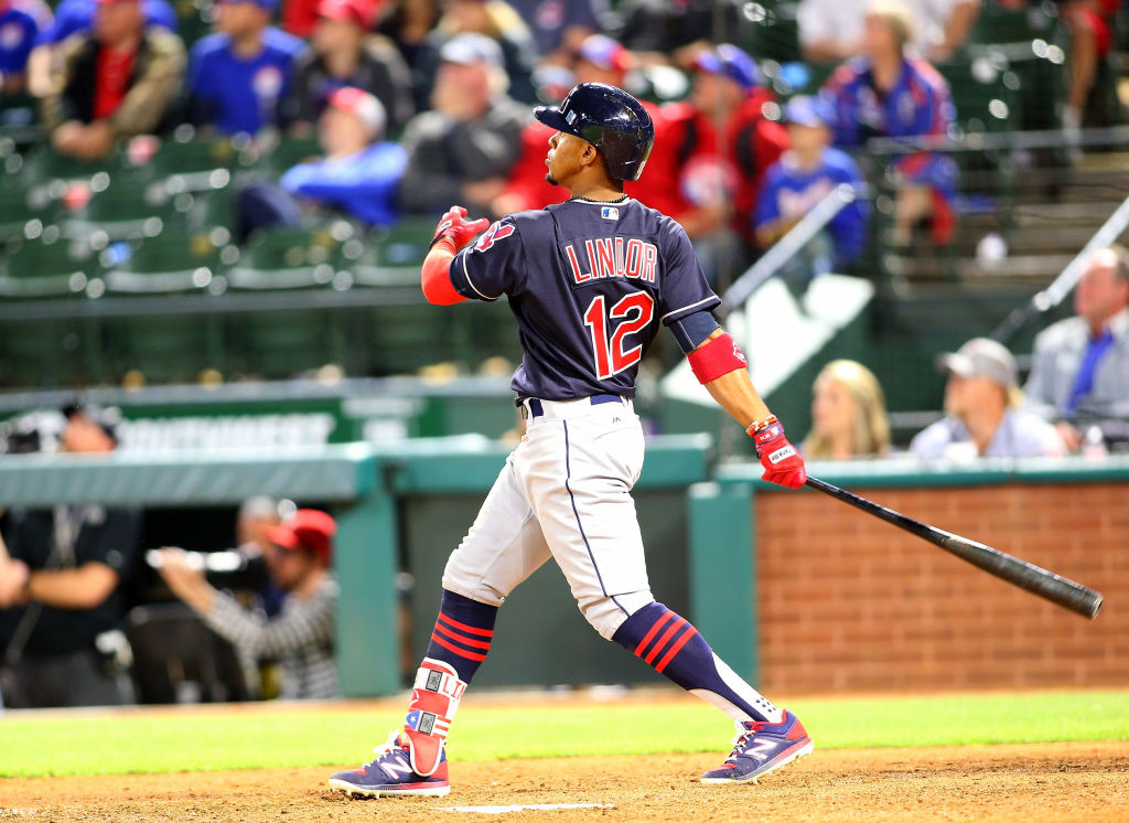 ARLINGTON, TX - APRIL 05: Francisco Lindor #12 of the Cleveland Indians hits a grand slam in the ninth inning against the Texas Rangers at Globe Life Park in Arlington on April 5, 2017 in Arlington, Texas