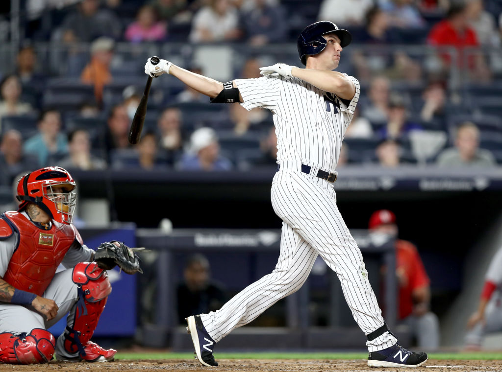NEW YORK, NY - APRIL 16: Greg Bird #33 of the New York Yankees hits a two run home run as Yadier Molina #4 of the St. Louis Cardinals defends on April 16, 2017 at Yankee Stadium in the Bronx borough of New York City.