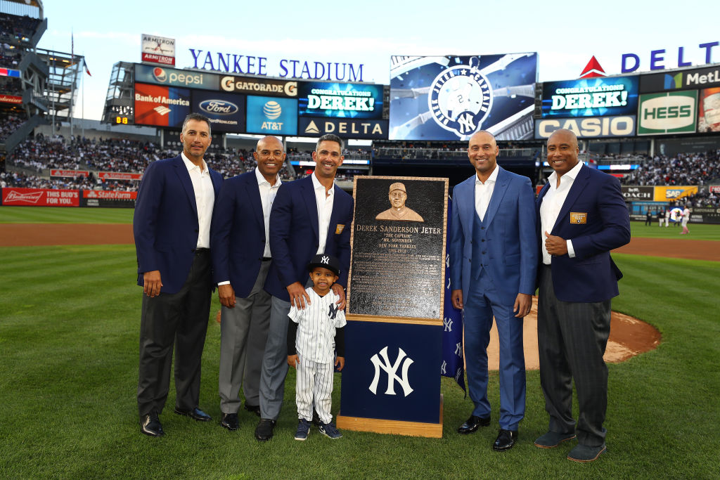 NEW YORK, NY - MAY 14: Derek Jeter poses with his former teamates Andy Pettitte, Mariano Rivera, Jorge Posada, and Bernie Williams during the retirement ceremony of his number 2 jersey at Yankee Stadium on May 14, 2017 in New York City.