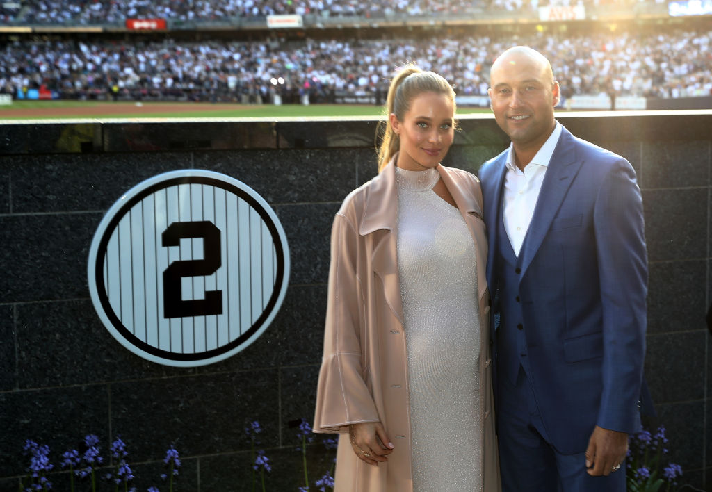 NEW YORK, NY - MAY 14: Former New York Yankees captain Derek Jeter and his wife Hannah Jeter pose next to his number in Monument Park during the retirement cerremony of Jeter's jersey #2 at Yankee Stadium on May 14, 2017 in the Bronx borough of New York City.