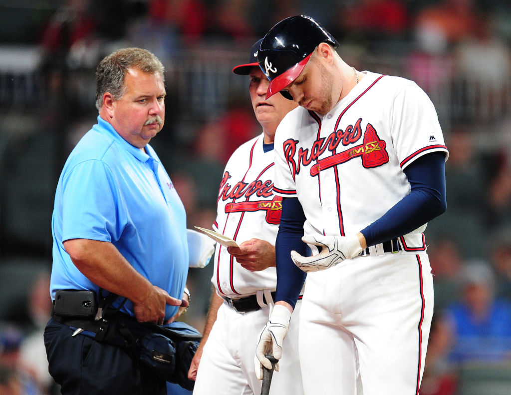 ATLANTA, GA - MAY 17: Freddie Freeman #5 of the Atlanta Braves is removed by Manager Brian Snitker #43 as trainer Jim Lovell watches after being hit by a fifth inning pitch against the Toronto Blue Jays at SunTrust Park on May 17, 2017 in Atlanta, Georgia