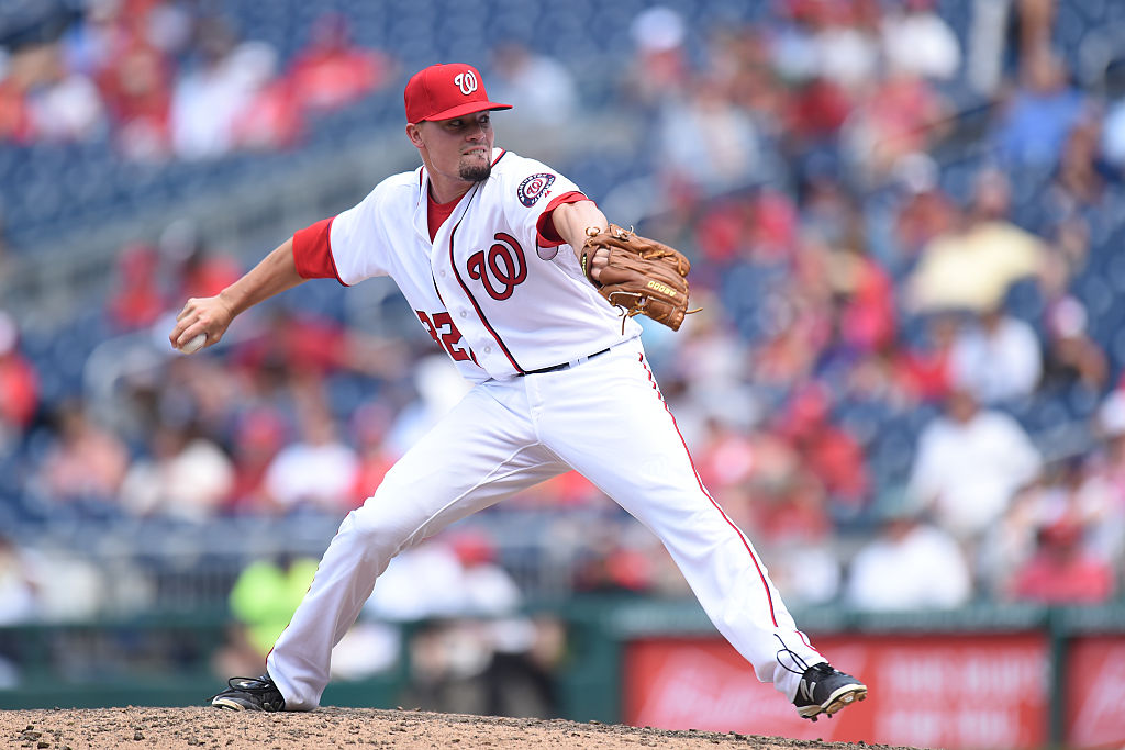 WASHINGTON, DC - JULY 21:  Koda Glover #34 of the Washington Nationals pitches in the ninth inning during a baseball game against the Los Angeles Dodgers at Nationals Park on July 21, 2016 in Washington, DC.