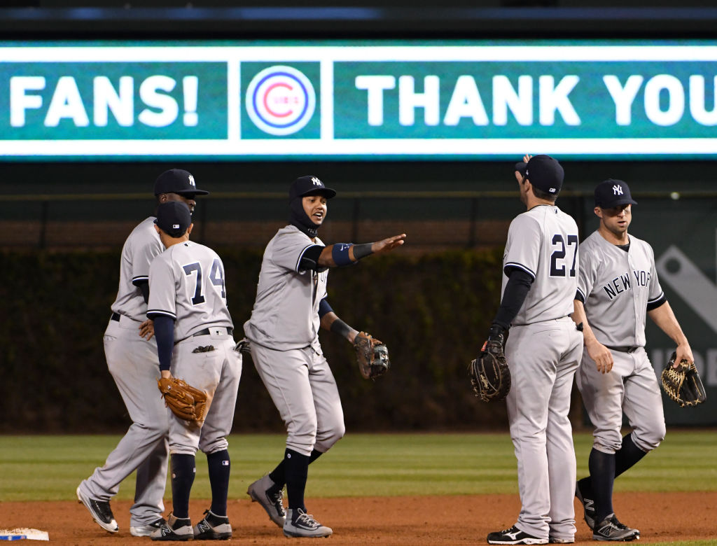 CHICAGO, IL - MAY 08: The New York Yankees celebrate their win against the Chicago Cubs on May 8, 2017 at Wrigley Field in Chicago, Illinois. The Yankees defeated the Cubs 5-4 in eighteen innings.