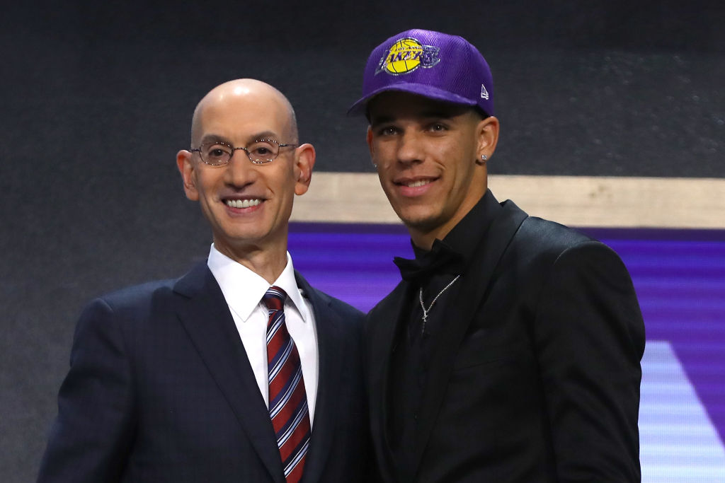 NEW YORK, NY - JUNE 22: Lonzo Ball walks on stage with NBA commissioner Adam Silver after being drafted second overall by the Los Angeles Lakers during the first round of the 2017 NBA Draft at Barclays Center on June 22, 2017 in New York City