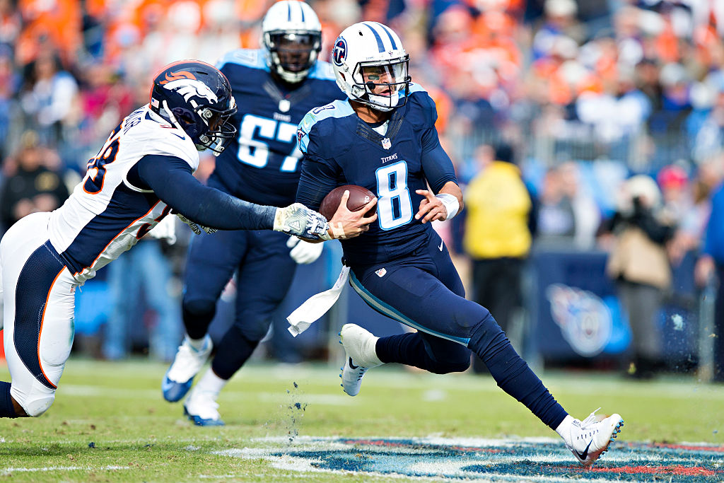 NASHVILLE, TN - DECEMBER 11: Marcus Mariota #8 of the Tennessee Titans slides to avoid the tackle of Von Miller #58 of the Denver Broncos at Nissan Stadium on December 11, 2016 in Nashville, Tennessee.