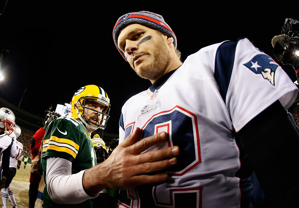 GREEN BAY, WI - NOVEMBER 30: Quarterback Tom Brady #12 of the New England Patriots walks away from Aaron Rodgers #12 of the Green Bay Packers after shaking hands following the NFL game at Lambeau Field on November 30, 2014 in Green Bay, Wisconsin. The Packers defeated the Patriots 26-21.