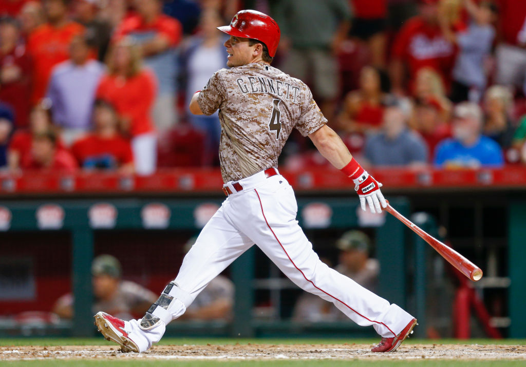 CINCINNATI, OH - MAY 06: Scooter Gennett #4 of the Cincinnati Reds watches his fourth home run against the St. Louis Cardinals at Great American Ball Park on June 6, 2017 in Cincinnati, Ohio.