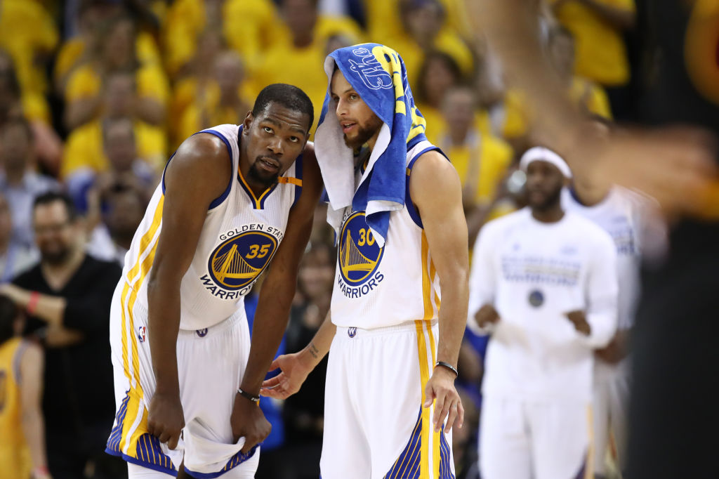 OAKLAND, CA - JUNE 12: Kevin Durant #35 and Stephen Curry #30 of the Golden State Warriors discuss the play against the Cleveland Cavaliers during the second half in Game 5 of the 2017 NBA Finals at ORACLE Arena on June 12, 2017 in Oakland, California.