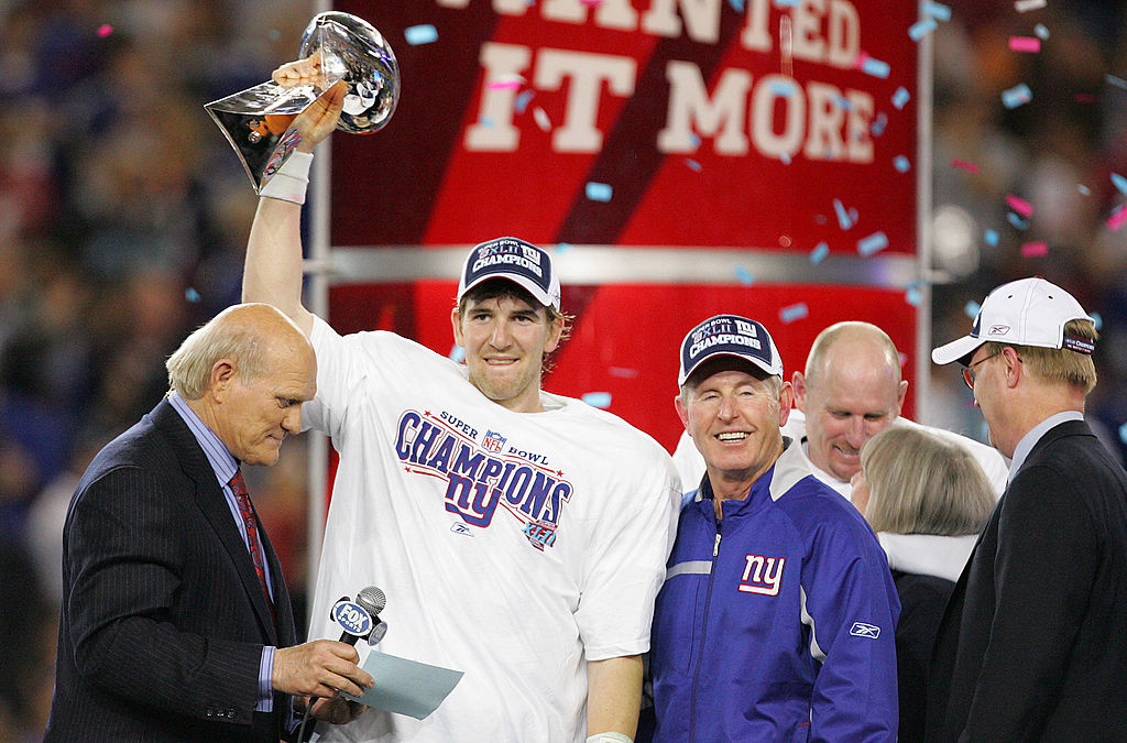 GLENDALE, AZ - FEBRUARY 03: Quarterback Eli Manning #10 of the New York Giants holds the Vince Lombardi Trophy after defeating the New England Patriots 17 0 14 after Super Bowl XLII on February 3, 2008 at the University of Phoenix Stadium in Glendale, Arizona.