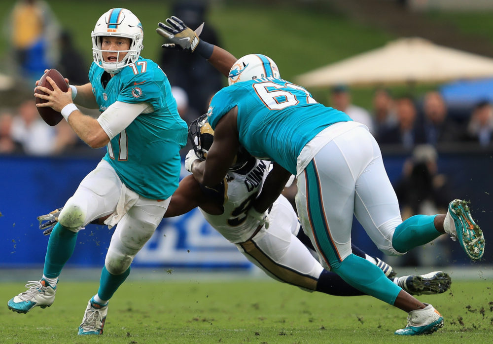 LOS ANGELES, CA - NOVEMBER 20: Quarterback Ryan Tannehill #17 of the Miami Dolphins runs with the ball during the second quarter of the game against the Los Angeles Rams at Los Angeles Coliseum on November 20, 2016 in Los Angeles, California
