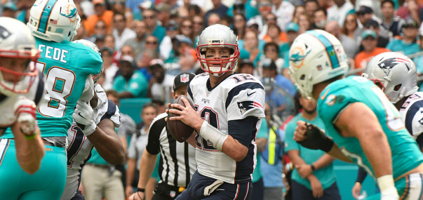 MIAMI GARDENS, FL - JANUARY 01: Tom Brady #12 of the New England Patriots looks downfield during the 1st quarter against the Miami Dolphins at Hard Rock Stadium on January 1, 2017 in Miami Gardens, Florida.