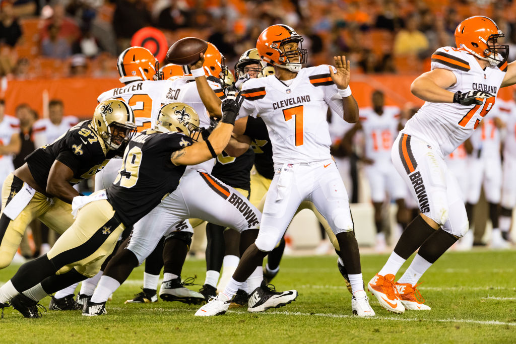 CLEVELAND, OH - AUGUST 10: Quarterback DeShone Kizer #7 of the Cleveland Browns passes while under pressure from linebacker Adam Bighill #99 of the New Orleans Saints during the second half of a preseason game at FirstEnergy Stadium on August 10, 2017 in Cleveland, Ohio. The Browns defeated the Saints 20-14.