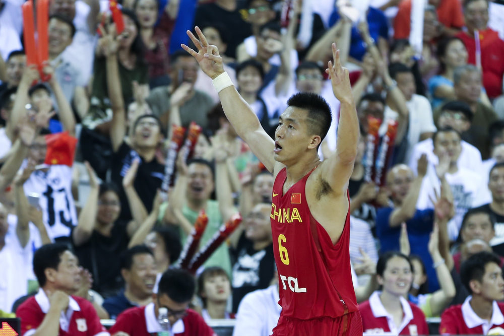 JILIN, CHINA - JULY 07: Guo Ailun of China celebrate his score during the 2017 Sino-Australia Men's International Basketball Challenge at Jilin stadium on July 7, 2017 in Jilin, China.