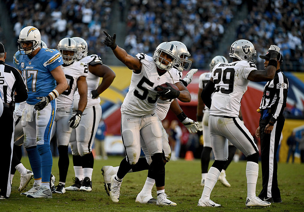 SAN DIEGO, CA - DECEMBER 18: Malcolm Smith #53 of the Oakland Raiders recovers fumble by Kenneth Farrow #27 of the San Diego Chargers en route to the Raiders 19-16 win over Chargers at Qualcomm Stadium on December 18, 2016 in San Diego, California.