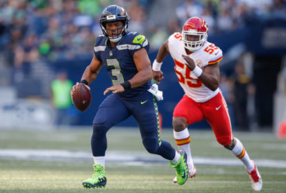 SEATTLE, WA - AUGUST 25: Quarterback Russell Wilson #3 of the Seattle Seahawks rushes under pressure from linebacker Dee Ford #55 of the Kansas City Chiefs at CenturyLink Field on August 25, 2017 in Seattle, Washington.