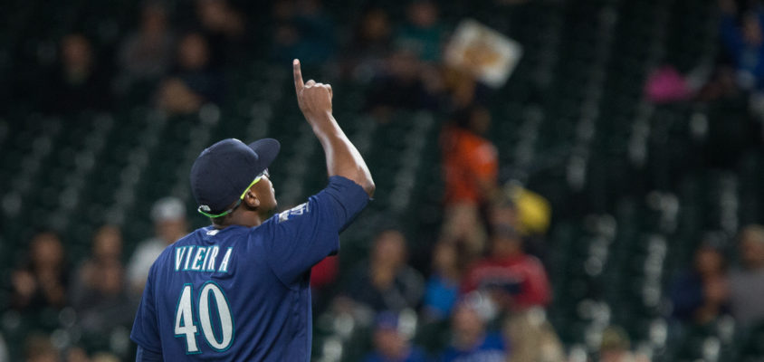 SEATTLE, WA - AUGUST 14: Thyago Vieira #40 walks off the field after going 1-2-3 in the top of the ninth inning during his major league debut against the Baltimore Orioles of the Seattle Mariners at Safeco Field on August 14, 2017 in Seattle, Washington.