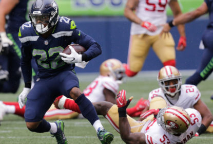 SEATTLE, WA - SEPTEMBER 17: Running back C.J. Prosise #22 of the Seattle Seahawks escapes linebacker NaVorro Bowman #53 of the San Francisco 49ers in the first quarter of the game at CenturyLink Field on September 17, 2017 in Seattle, Washington.