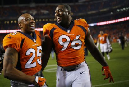 DENVER, CO - SEPTEMBER 11: Defensive end Shelby Harris #96 of the Denver Broncos celebrates winning the game with Chris Harris #25 against the Los Angeles Chargers at Sports Authority Field at Mile High on September 11, 2017 in Denver, Colorado. Harris blocked the game-tying field goal in the fourth quarter.