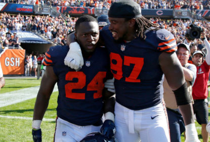 CHICAGO, IL - SEPTEMBER 24: Jordan Howard #24 and Willie Young #97 of the Chicago Bears celebrate after defeating the Pittsburgh Steelers 23-17 at Soldier Field on September 24, 2017 in Chicago, Illinois.