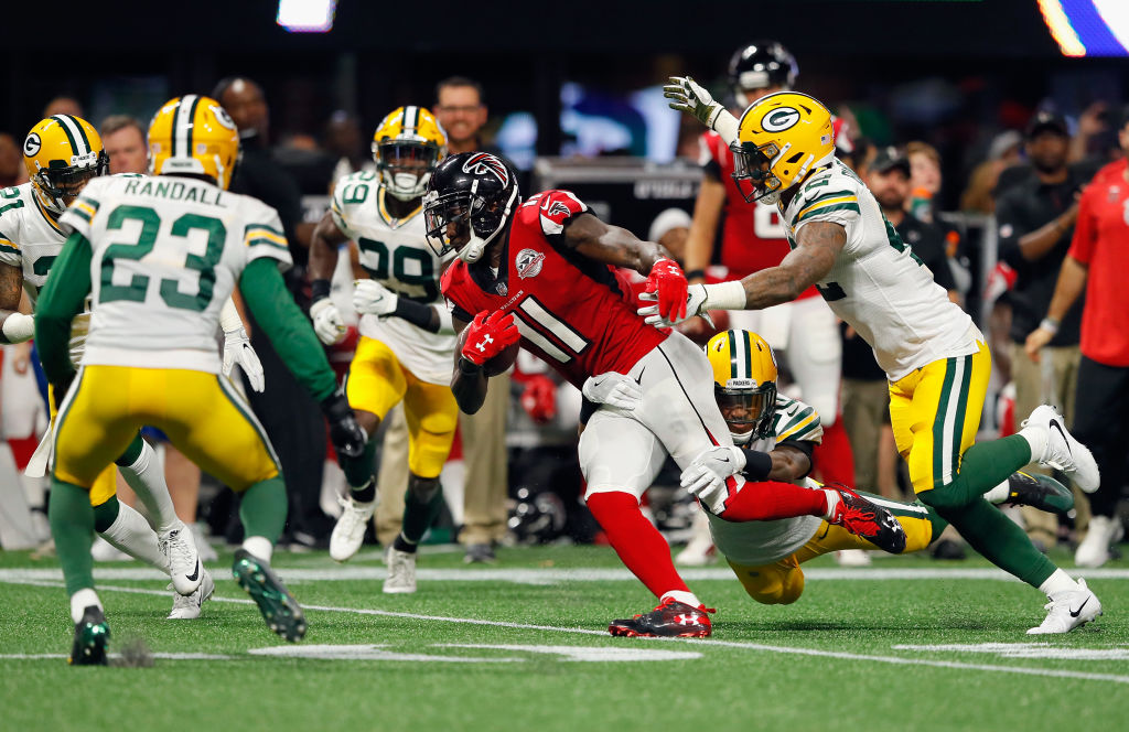 ATLANTA, GA - SEPTEMBER 17: Kevin King #20 and Morgan Burnett #42 of the Green Bay Packers attempt to tackle Julio Jones #11 of the Atlanta Falcons during the first half at Mercedes-Benz Stadium on September 17, 2017 in Atlanta, Georgia.