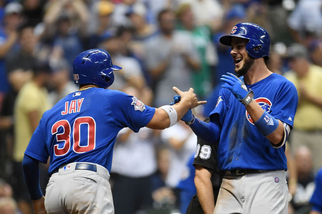 MILWAUKEE, WI - SEPTEMBER 21: Kris Bryant #17 of the Chicago Cubs is congratulated by Jon Jay #30 following a two run home run against the Milwaukee Brewers during the tenth inning of a game at Miller Park on September 21, 2017 in Milwaukee, Wisconsin.