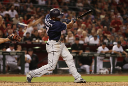 Manuel Margot #7 of the San Diego Padres hits a two RBI single against the Arizona Diamondbacks during the seventh inning of the MLB game at Chase Field on September 8, 2017 in Phoenix, Arizona.