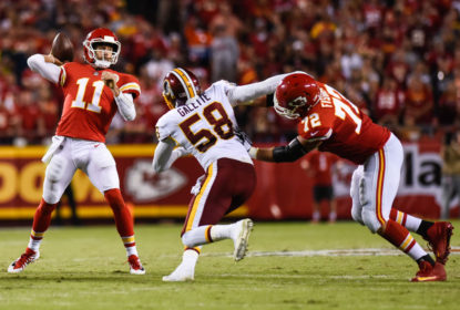 KANSAS CITY, MO - OCTOBER 2: Quarterback Alex Smith #11 of the Kansas City Chiefs throws a pass in front of the oncoming rush from linebacker Junior Galette #58 of the Washington Redskins during the second quarter at Arrowhead Stadium on October 2, 2017 in Kansas City, Missouri.