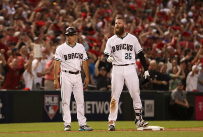 Archie Bradley #25 of the Arizona Diamondbacks reacts after hitting aN RBI triple during the bottom of the seventh inning of the National League Wild Card game against the Colorado Rockies at Chase Field on October 4, 2017 in Phoenix, Arizona