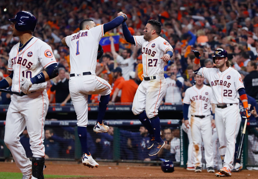 HOUSTON, TX - OCTOBER 29: Carlos Correa #1 of the Houston Astros celebrates with Jose Altuve #27 after hitting a two-run home run during the seventh inning against the Los Angeles Dodgers in game five of the 2017 World Series at Minute Maid Park on October 29, 2017 in Houston, Texas.