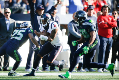 SEATTLE, WA - OCTOBER 29: Quarterback Deshaun Watson #4 of the Houston Texans prepares for a tackle as he rushes against cornerback Richard Sherman #25 of the Seattle Seahawks in the third quarter at CenturyLink Field on October 29, 2017 in Seattle, Washington.