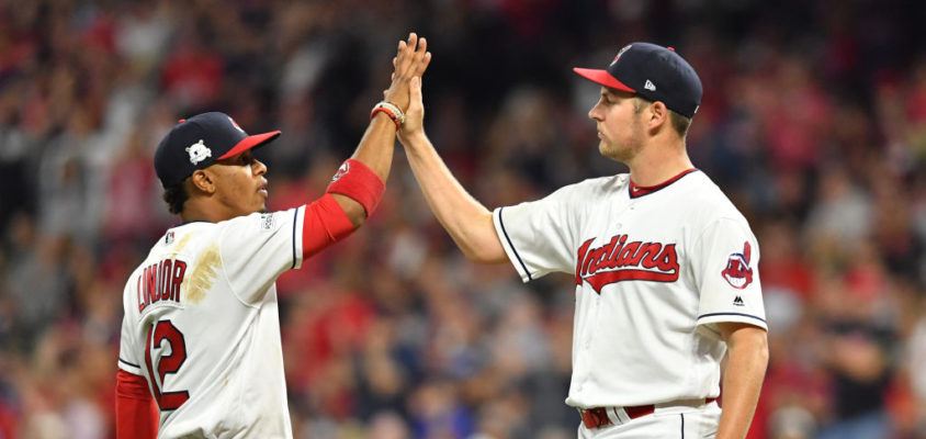 CLEVELAND, OH - OCTOBER 05: Francisco Lindor #12 congratulates Trevor Bauer #47 of the Cleveland Indians as he is taken out of the game during the seventh inning against the New York Yankees during game one of the American League Division Series at Progressive Field on October 5, 2017 in Cleveland, Ohio.