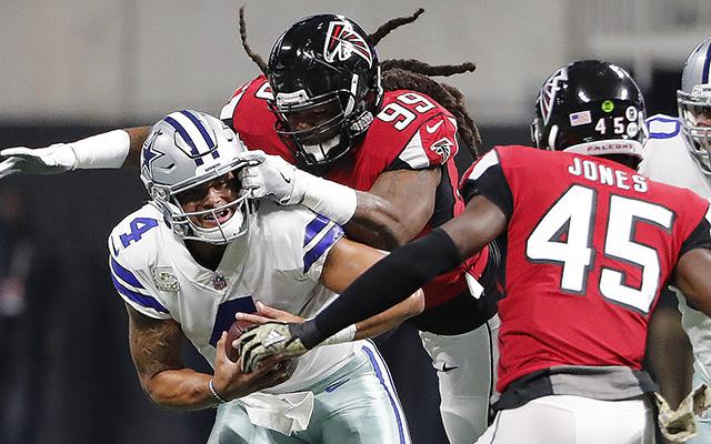 Atlanta Falcons defensive end Adrian Clayborn (99) sacks Dallas Cowboys quarterback Dak Prescott (4) during the first half of an NFL football game, Sunday, Nov. 12, 2017, in Atlanta. (AP Photo/David Goldman)