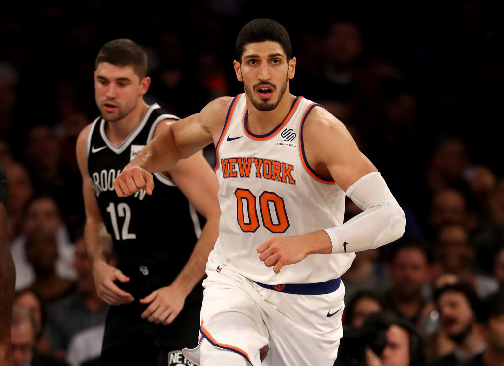 NEW YORK, NY - OCTOBER 27: Enes Kanter #00 of the New York Knicks celebrates his basket in the second half as Joe Harris #12 of the Brooklyn Nets looks on at Madison Square Garden on October 27, 2017 in New York City