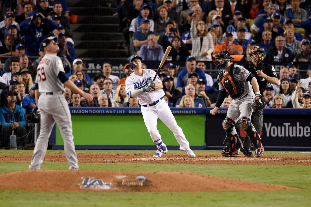 LOS ANGELES, CA - OCTOBER 31: Joc Pederson #31 of the Los Angeles Dodgers hits a solo home run during the seventh inning against the Houston Astros in game six of the 2017 World Series at Dodger Stadium on October 31, 2017 in Los Angeles, California.