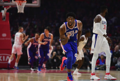 Joel Embiid #21 of the Philadelphia 76ers reacts to his three pointer during the first half against the LA Clippers at Staples Center on November 13, 2017 in Los Angeles, California.