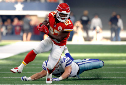 ARLINGTON, TX - NOVEMBER 05: Kareem Hunt #27 of the Kansas City Chiefs gains first down yardage against Sean Lee #50 of the Dallas Cowboys in the second quarter of a football game at AT&T Stadium on November 5, 2017 in Arlington, Texas.