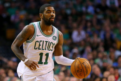BOSTON, MA - OCTOBER 24: Kyrie Irving #11 of the Boston Celtics dribbles against the New York Knicks during the first half at TD Garden on October 24, 2017 in Boston, Massachusetts.