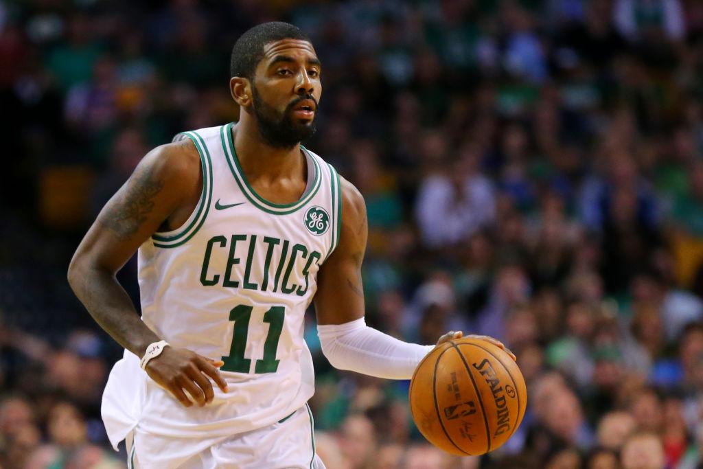 BOSTON, MA - OCTOBER 24: Kyrie Irving #11 of the Boston Celtics dribbles against the New York Knicks during the first half at TD Garden on October 24, 2017 in Boston, Massachusetts.