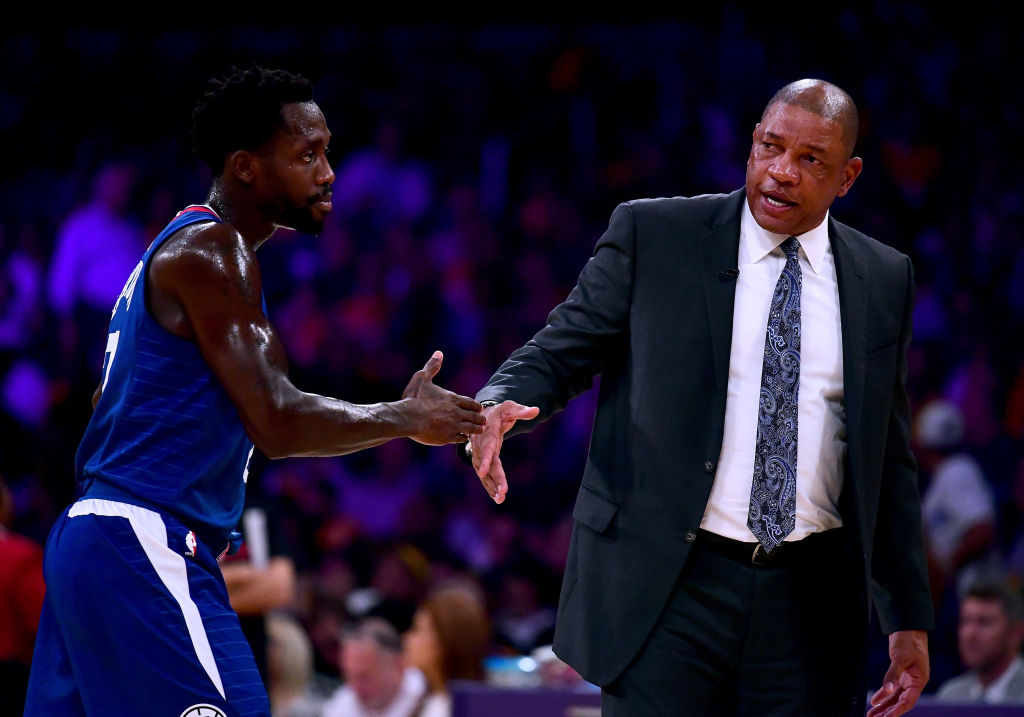 Head coach Doc Rivers of the LA Clippers touches hands with Patrick Beverley #21 in a 108-92 Clipper win during the Los Angeles Lakers home opener at Staples Center on October 19, 2017 in Los Angeles, California.