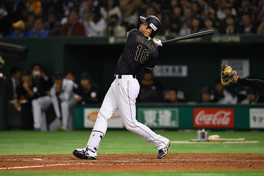 TOKYO, JAPAN - NOVEMBER 13: Pinch hitter Shohei Ohtani #16 of Japan hits a double, which is stuck on ceiling of the stadium, in the seventh inning during the international friendly match between Netherlands and Japan at the Tokyo Dome on November 13, 2016 in Tokyo, Japan.