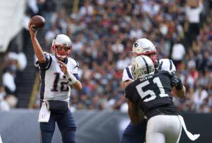 MEXICO CITY, MEXICO - NOVEMBER 19: Tom Brady #12 of the New England Patriots throws a pass against the Oakland Raiders during the first half at Estadio Azteca on November 19, 2017 in Mexico City, Mexico.