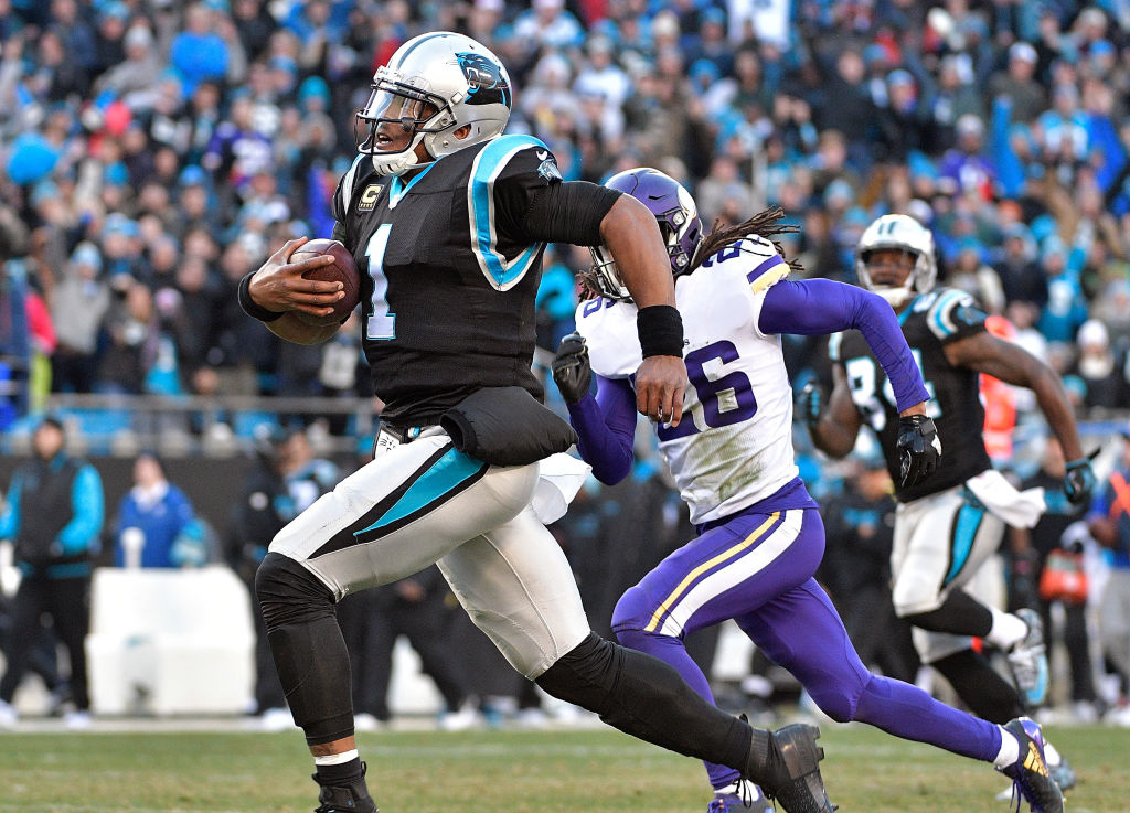 Cam Newton #1 of the Carolina Panthers sprints past Trae Waynes #26 of the Minnesota Vikings for a long gain to set up the game-winning touchdown during their game at Bank of America Stadium on December 10, 2017 in Charlotte, North Carolina.