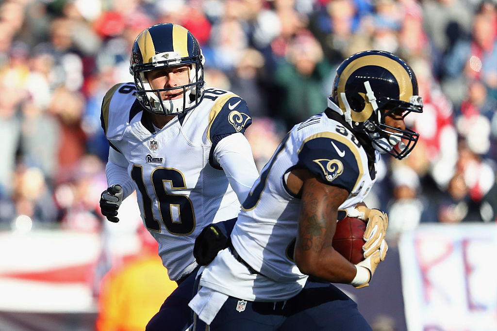 Jared Goff #16 of the Los Angeles Rams hands the ball off to Todd Gurley #30 during the first half against the New England Patriots at Gillette Stadium on December 4, 2016 in Foxboro, Massachusetts.