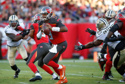 TAMPA, FL - DECEMBER 31: Quarterback Jameis Winston #3 of the Tampa Bay Buccaneers runs for 17 yards during the first quarter of an NFL football game against the New Orleans Saints on December 31, 2017 at Raymond James Stadium in Tampa, Florida.