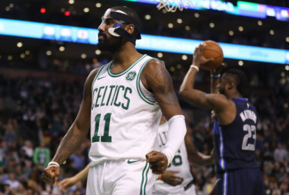 BOSTON, MA - DECEMBER 6: Kyrie Irving #11 of the Boston Celtics celebrates during the second half against the Dallas Mavericks at TD Garden on December 6, 2017 in Boston, Massachusetts. The Celtics defeat the Mavericks 97-90.